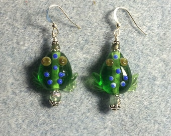 Transparent emerald green lampwork frog bead earrings adorned with green Czech glass beads.