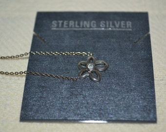 """Sterling Silver flower necklace with rhinestone in center of flower. 16"""" long"""