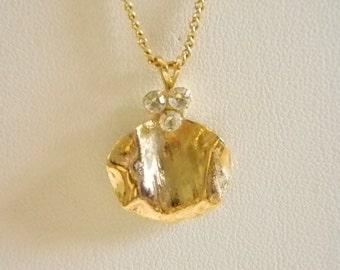 Round Gold Tone Clear Rhinestone Pendant Necklace