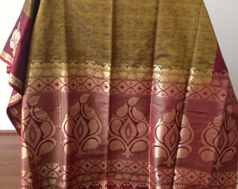 Assam silk saree with grey gold and coppery red Paisley design and separate design for pallu and folds
