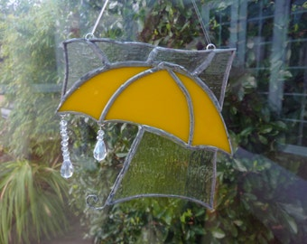 Umbrella in the rain made from stained glass