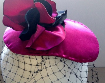 Black & purple/pink handmade ladies alternative/rock 'n' roll fascinator hat with black veiling and satin floral decoration