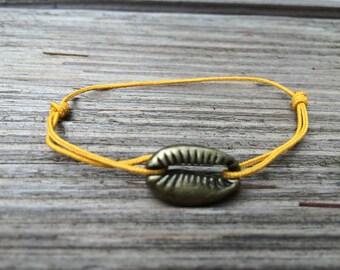 Bronze shell bracelet and mustard cord