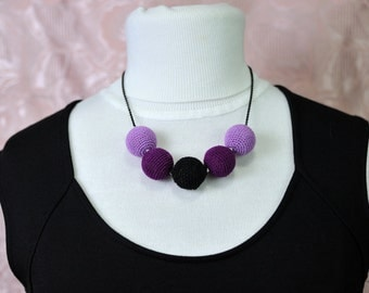 Necklace with scented wooden balls coated with crochet technique