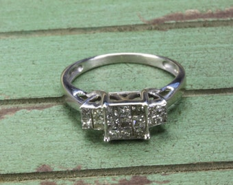Estate 14K Gold Engagement Ring Adorned with 14 Diamonds