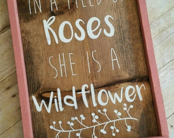 In a field of roses she is a wildflower wood framed sign