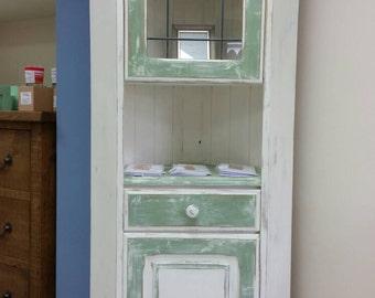 Shabby chic handpainted pine corner unit. Green and antique white.