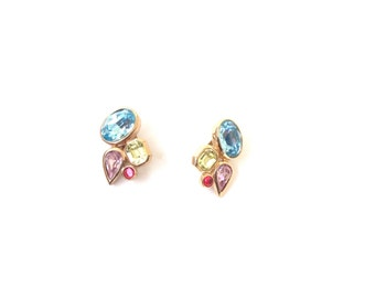 faceted multicolor rhinestone clip on earrings. Abstract gold tone ear candy, statement jewelry. Vtg clip on earrings.