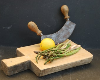 Small, chunky  wooden board with it's herb chopper. The board has a great shape, thicker on one side. French Vintage farmhouse