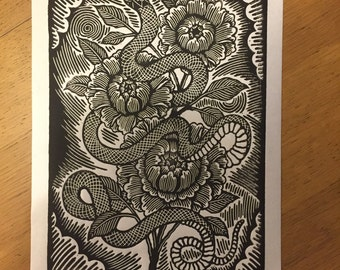 snake and flowers linocut