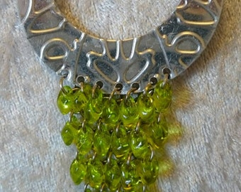 Hand embossed beaded pendant necklace