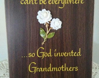 """Vintage grandmother plaque."""" Mothers can't be everywhere... so God invented grandmothers"""". Gold colored lettering on wood laminated plaque"""