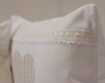 2 pieces of fine white cushion