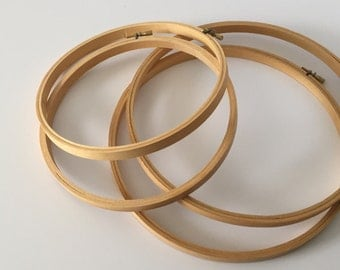 "4 wooden embroidery hoops. 2 - 8"" and 2 - 10"""