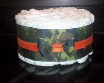 Green Camo Camouflage 1 Tier Diaper Cake with Orange Ribbon Accent Handmade Bows Size 1 Huggies Diapers Baby Shower Decor Table Centerpiece