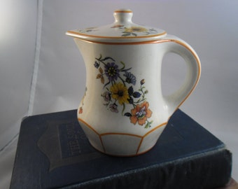 "Thompson Creamer ""field flowers"" pottery"