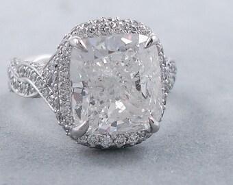 Glamorous 6.73 ctw Cushion cut diamond ring with a 5.50 ct F/SI3 Clarity Enhanced Cushion cut diamond