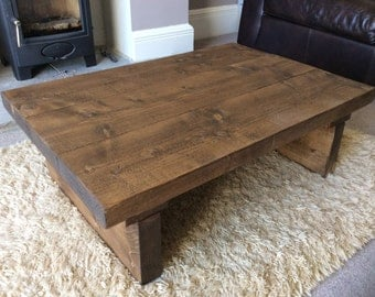 Rustic handcrafted reclaimed wooden coffee table in walnut wax.
