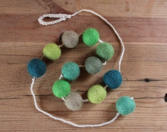 Cotton yarn necklace and felt balls.