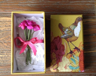 Miniature bunch of pink roses in a gift box