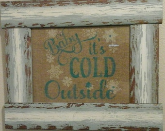 Rustic framed baby it's cold outside burlap saying.