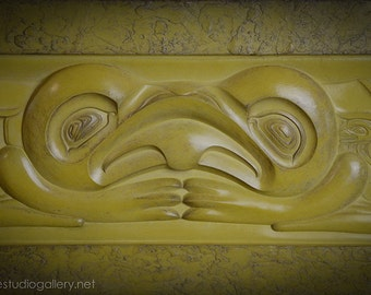 Pacific Northwest Coast Split Frog Plaque cast in florentine stone with a golden yellow finish.