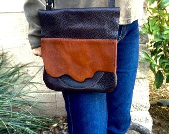 Adjustable premium leather, hair on hide, messenger bag