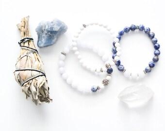 Beautiful stack of bracelets made of semi-precious stones,white jade, blue spot stone, Alice blue jade, silver spacer, yoga, meditation