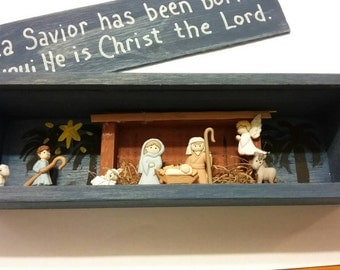 "Nativity scene slide top shadow box - ""...a Savior has been born to you; He is Christ the Lord."" With wooden Manger and painted scene"