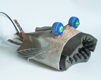 Fish lamp. Made from recycled materials. Sculpture with light.