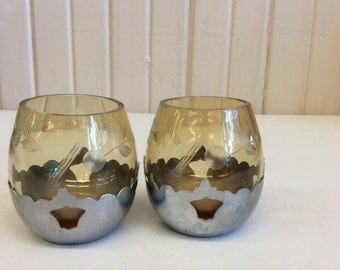 Amber color candle holders with silver bottom