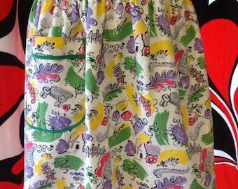 Vintage cotton apron with green trim, 'park print', gelato colour and pocket.