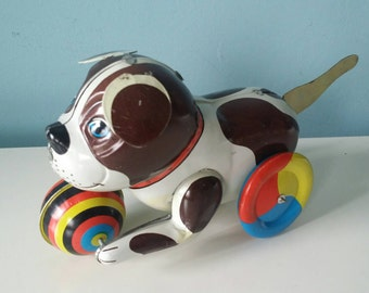 Cute tin friction toy dog on wheels made in China 60s vintage in working condition