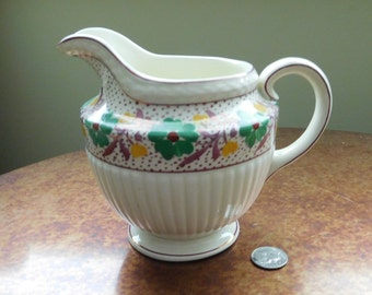 Wedgwood creamer made for Marshall Fields of Chicago.  Excellent condition.  Vintage.  Floral.