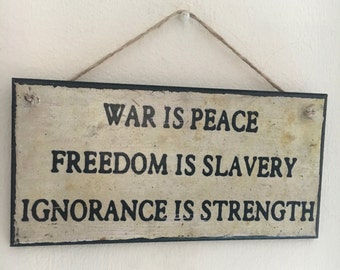 """1984 book ~ George Orwell inspired ~ quote """"War is Peace, Freedom is Slavery, Ignorance is Strength"""" wall plaque"""