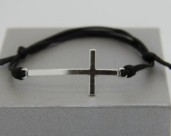 Man and woman cross metal with adjustable cord bracelet