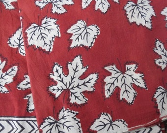 Red and white leaf print fabric