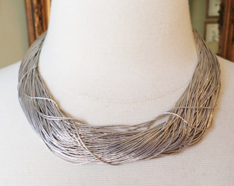 Liquid Silver Stamped Multiple Strands Heavy 78.7 grams Necklace.