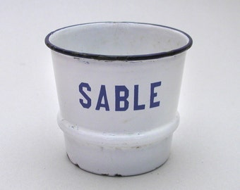 Small white and blue enamel pot