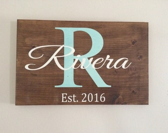 Personalized reclaimed wood family name sign