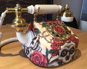 Old phone to dial vintage, old phone to retro antique roulette table beige cornet with death's head Alexander Henry fabric