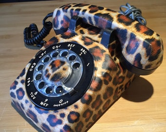 Old phone to dial vintage, old phone to retro antique roulette table black with leopard fabric