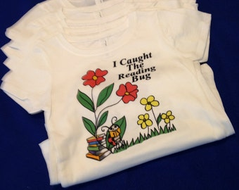 I Caught The Reading Bug graphic tee shirt