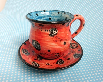 Cup and saucer by Mary Rose Young 1987
