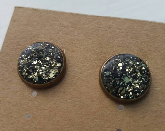 Ear candy // sparkly earrings // gold + black studs