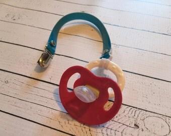 Aqua blue sparkle binkie clip