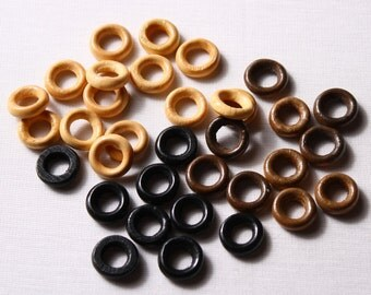 25 small rings 15mm of wood (7140)