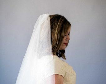 Elbow length circle veil