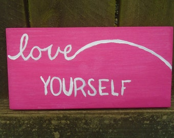 pink love yourself sign
