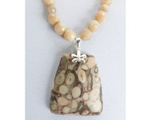 Fossilizd Coral pendant with faceted Sunstone beads